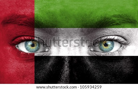 Human face painted with flag of United Arab Emirates