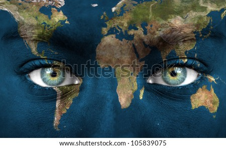 """Human face painted with planet earth - """"Elements of this image furnished by NASA"""" - stock photo"""