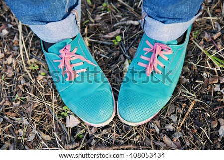 Human feet in shoes with colorful laces #408053434