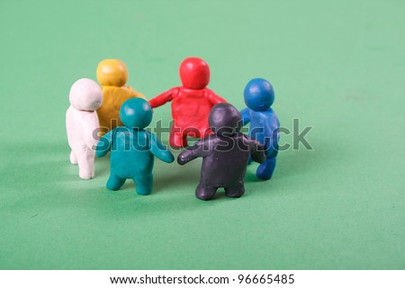 human figures from clay stand in a circle