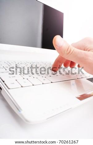 Human finger on a laptop keyboard. Typing