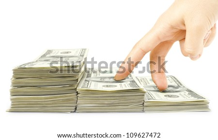 Human fingers go up the stairs dollars