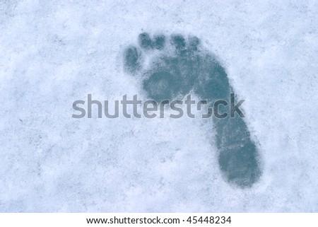 human footprint on blue ice