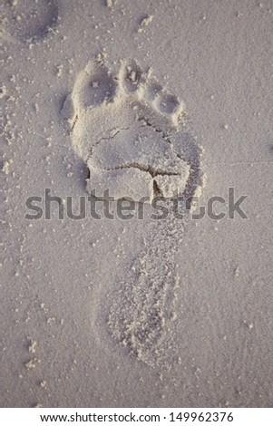 human footprints on the beach sand