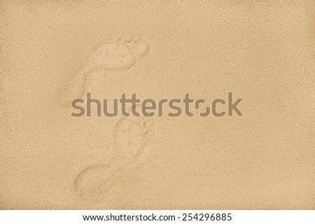 human footprints on the beach sand, sea vacation concept