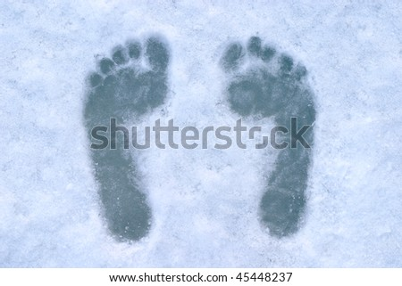 human footsteps on blue ice - stock photo
