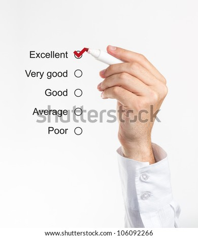 Human hand checking the rating form