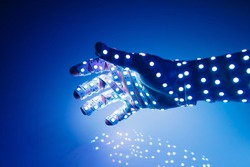 human hand covered with blue led lights, illuminated background