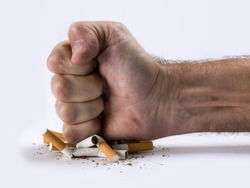 Human hand crushed some cigarettes