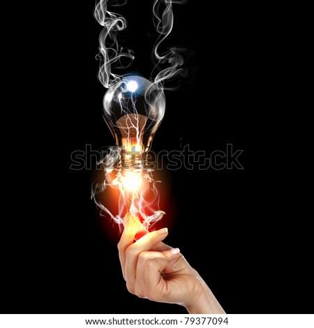 human hand, electric charge and light bulb