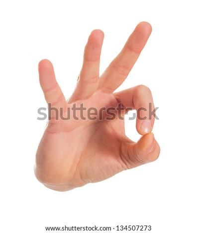 Human Hand Gesturing Ok Sign On White Background