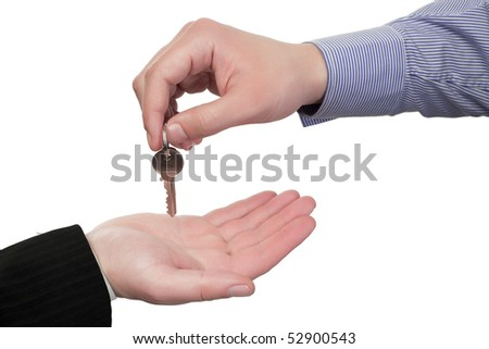 Human hand giving the keys