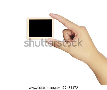 Human hand holding a blank of vintage photo frame