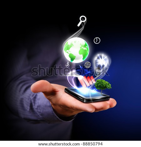 Human hand holding a mobile phone sending images
