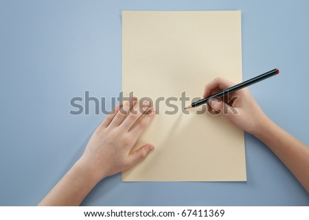 Human hand holding a pencil,ready to write.