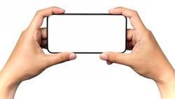 Human hand holding a virtual cell phone is playing game or watching movie on screen, isolated on white background.