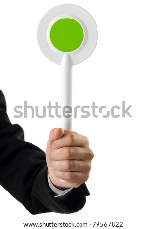 Human hand holding auction paddle voting card sign