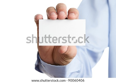 Human hand holding blank business card with copy space