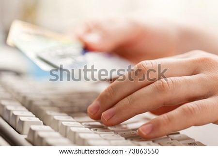 Human hand holding business finance credit cards