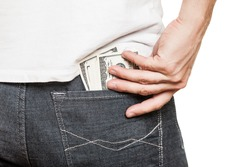 Human hand holding dollar currency cash taking banknote out of jeans pocket