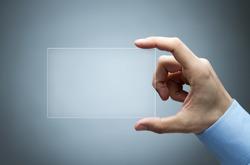 Human hand holding futuristic business card