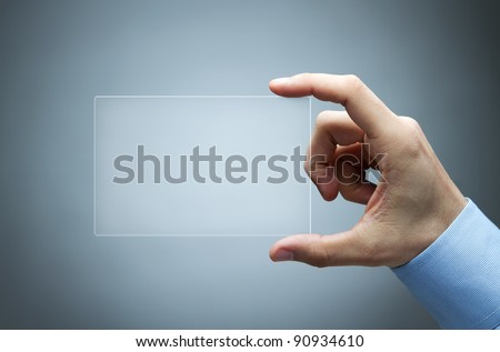 Human hand holding futuristic business card
