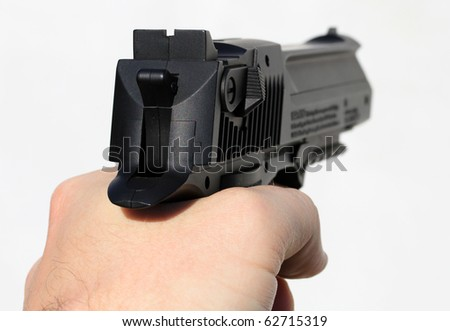 Human hand holding gun isolated on white