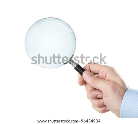 Human hand holding magnifying glass with clipping path for the inside