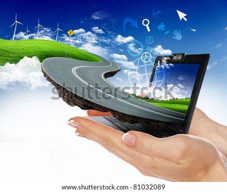 human hand holding notebook and nature landscape in it
