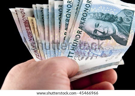 Human hand holding swedish money  / Swedish currency