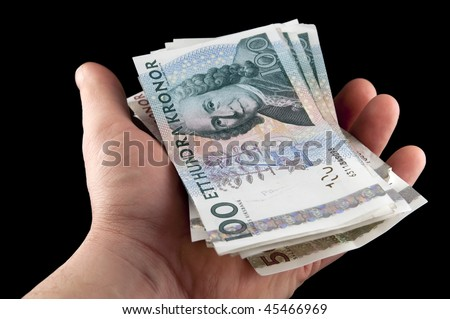 Human hand holding swedish money  / Swedish currency