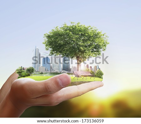 human hand holding the city