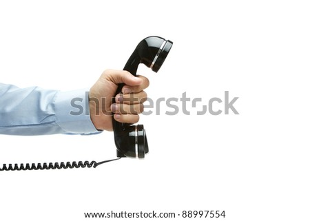 Human hand holding vintage telephone, isolated on white with copy space