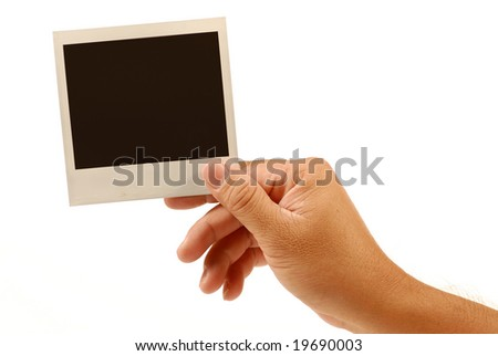 human hand is holding blank instant photo picture