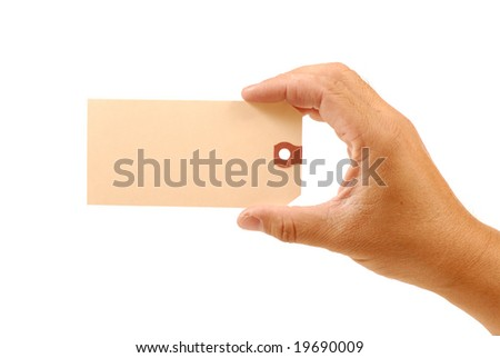 human hand is holding price tag