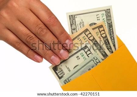 Human hand is taking out money from a yellow envelope. Isolated on White.