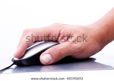 Human hand operating a computer mouse on a reflective surface