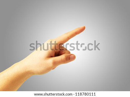 Human Hand Pointing On Gray Background