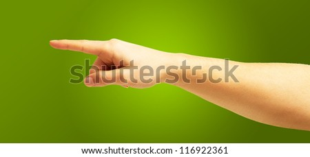 Human Hand Pointing On Green Background