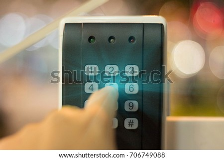 Human hand presses on the button, entering security system code. Combination PIN code on keypad. Password house alarm. Digital combination lock wall. #706749088