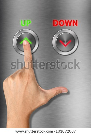 Human hand pressing up button on metallic background