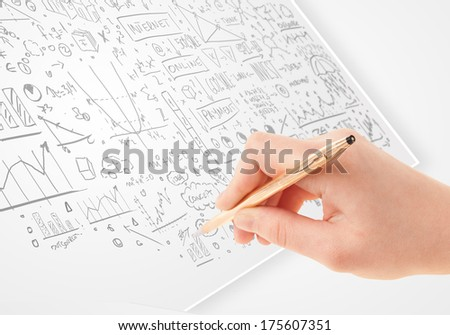 Human hand sketching multiple ideas on a paper
