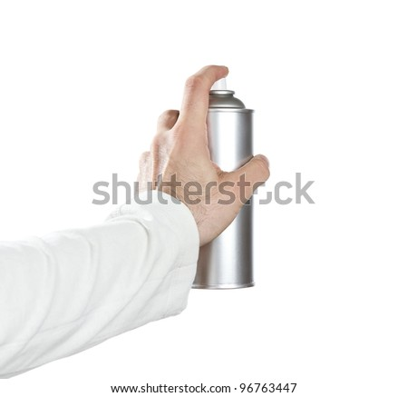 Human hand spraying with paint over white background