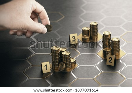 Human hand stacking coins over black background with hexagonal golden shapes. Concept of angel investor and investing in startup companies. Composite image between a hand photography and a 3D backgrou ストックフォト ©
