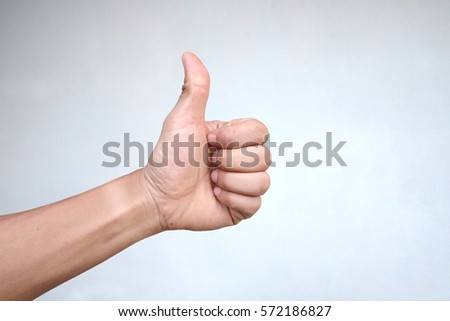 Human hand thumb up on white background.
