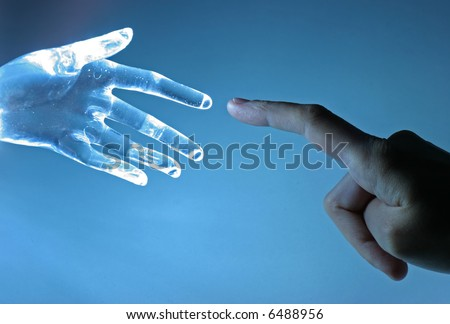 Human hand touch an atrifical glass hand