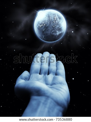 Human hand touching planet earth - stock photo