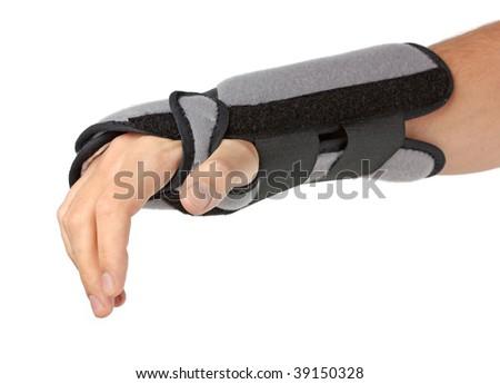 Human hand with a wrist brace, orthopedic equipment over white