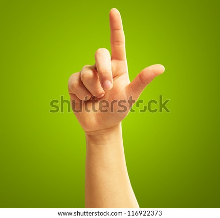 Human Hand With Point Finger On Green Background