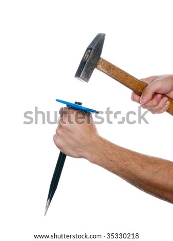 Human hand working with chisel tool and hammer